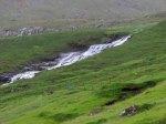 Breiðá cascades between the two falls.