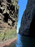 Narrow passage between cliffs and sea stacks