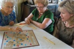 Jenny playing Scrabble with sister Miriam and niece Beverly